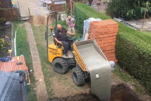 Person laying foundation after structural engineering