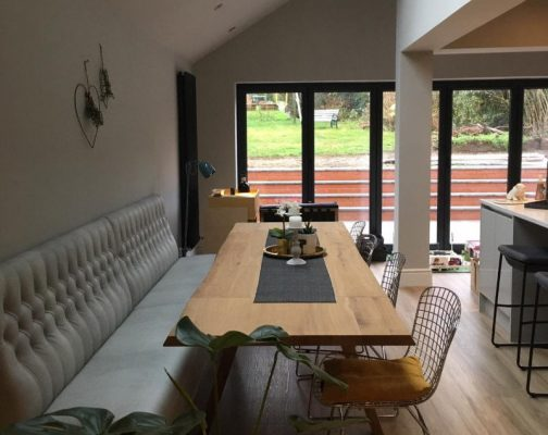 table and seating in house extension